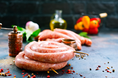 raw sausages with spice on a table Stock Photo