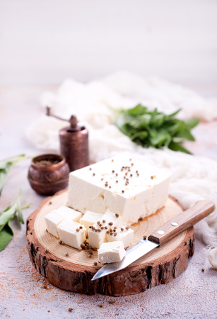 cheese on board and on a table, stock photo Standard-Bild