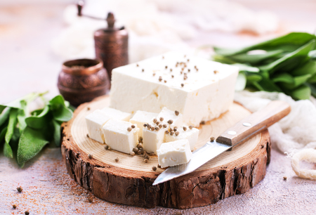 cheese on board and on a table, stock photo Stok Fotoğraf - 85540359