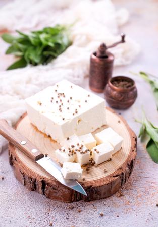 船上のチーズとテーブルの上 写真素材