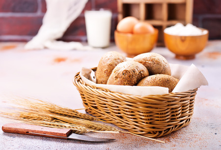 fresh bread in basket and on a table