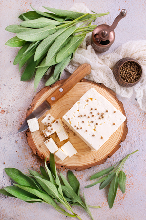 cheese on board and on a table, stock photo Stok Fotoğraf - 85540523
