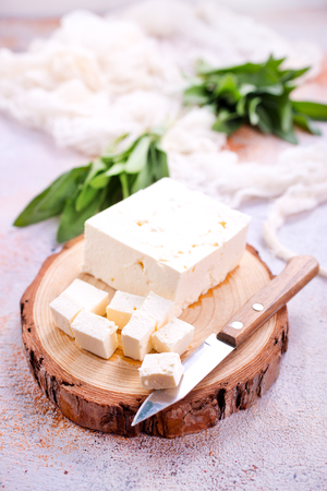 cheese on board and on a table, stock photo Stok Fotoğraf