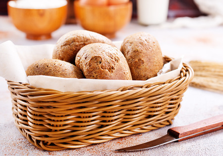 fresh bread in basket and on a table Stock fotó - 85540384