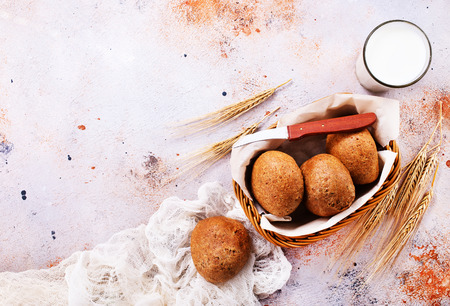 fresh bread in basket and on a table Stock fotó - 85540470