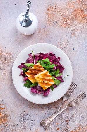 salad with fried cheese on white plate Stock Photo