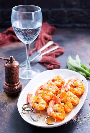 fried shrimps on white plate and on a table