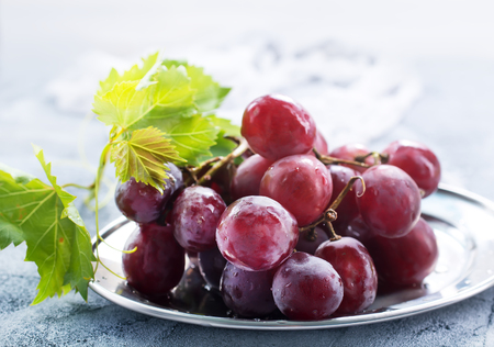 fresh grape on plate and on a table