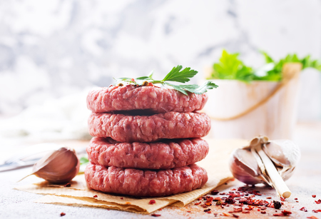 raw cutlets for burger, raw cutlets on a table Stock Photo