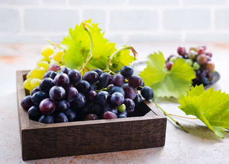 grape on a table, black and green grape