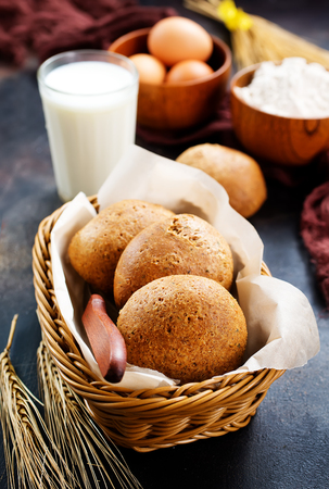 fresh wheat bread in basket and on a table