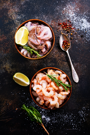 seafood in bowls and on a table
