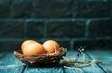 brown easter eggs on a table, easter background Stock Photo