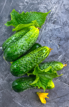 fresh cucumbers on the wooden table, stock photo