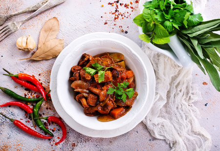 fried mushrooms with vegetables and tomato sauce Stock Photo