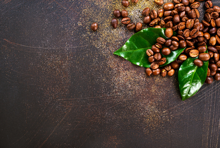 coffee beans and green leaf on a table Фото со стока