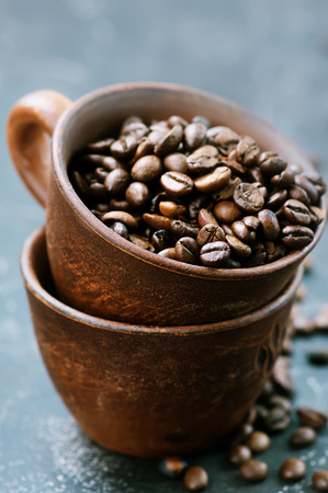 coffee beans in cup and on a table