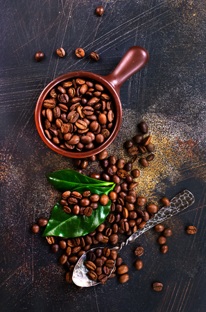 coffee beans and green leaf on a table Stok Fotoğraf