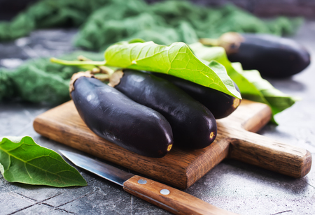 raw eggplant on a table, stock photo