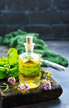 mint oil in bottle and on a table