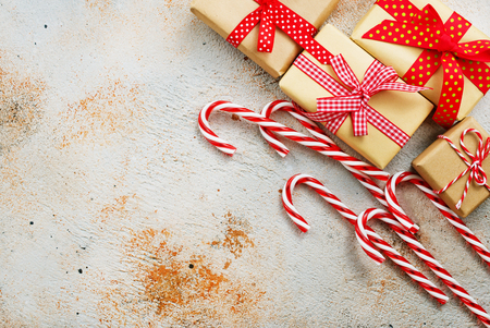 box for present and candy canes on a table Stok Fotoğraf - 90078506