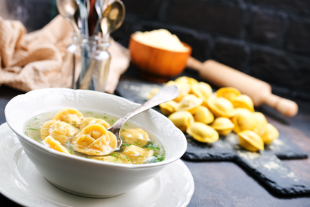 Boiled dumplings in bowl and on a table