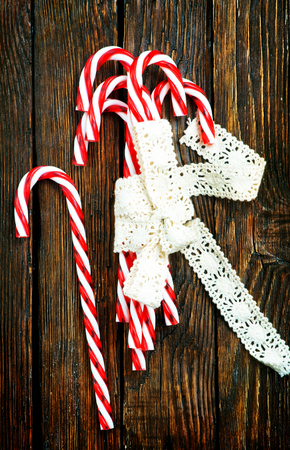 candycanes with white ribbon on the wooden table Stock Photo