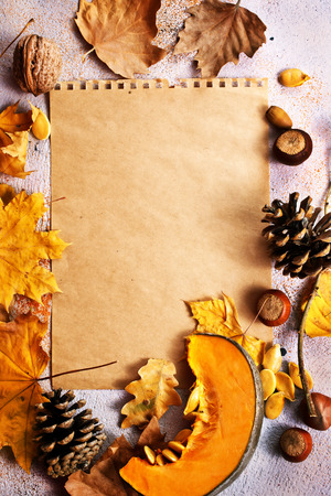 autumn background, dry leaves and paper on a table, stock photo Stock Photo - 90766603