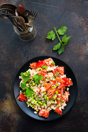 fresh salad with tomato and shrimps on the plate Stock Photo