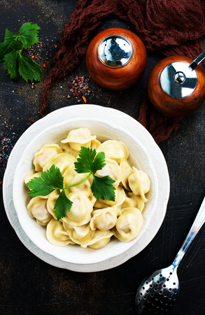 Homemade meat dumplings - russian pelmeni. Stock photo