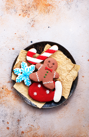sweet christmas cookie on plate and on a table