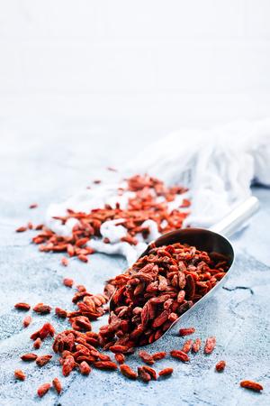 dry goji berries on a table, stock photo Stock fotó