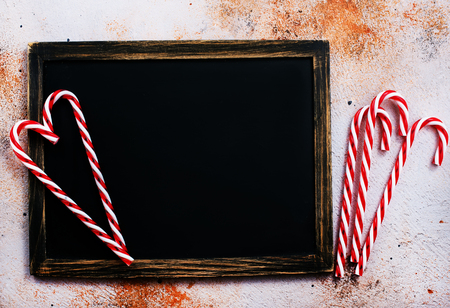 christmas background, candy cane on a table, copy space