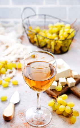 white wine and cheese on a table Stock Photo