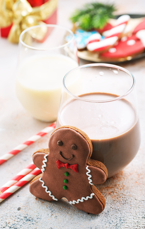 cocoa drink and gingerbread on a table