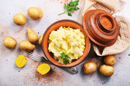 mashed potato in bowl on a table Stock Photo