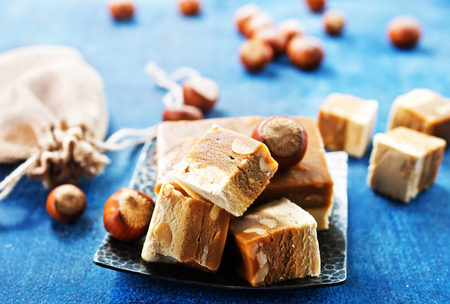 sweet nougat with nuts on blue tableware