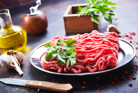 minced meat with spice and fresh herb on a table Stock Photo
