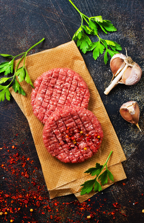 raw cutlets for burger with salt and aroma spice Stockfoto