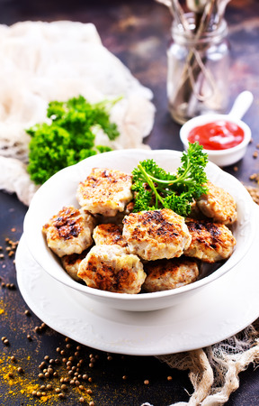 cutlets in bowl and on the table, stock photo