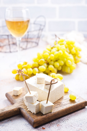wine and cheese on a table, stock photo