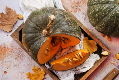 raw pumpkin on a table, stock photo