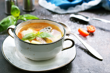 fish soup in bowl and on a table