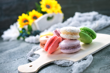 color macaroons on board and on a table Stockfoto