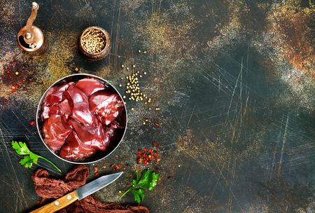 raw liver with salt and spice on a table Archivio Fotografico