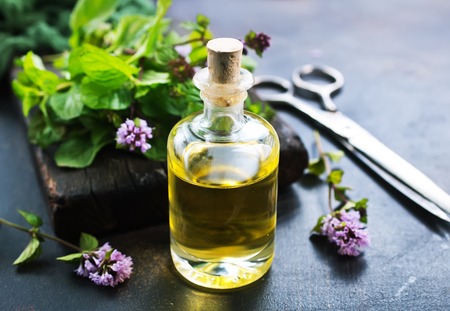 herbal oil in bottle and on a table
