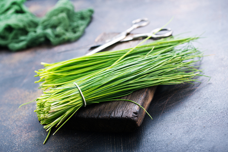 green onion on board and on a table