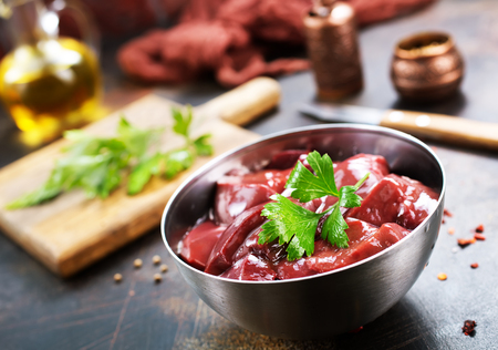 raw liver with salt and spice on a table Stock Photo