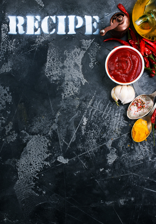 tomato sauce in white bowl on a table Stock Photo