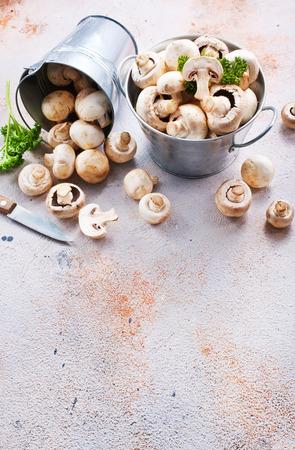 raw mushrooms in metal bucket, champignons in bucket